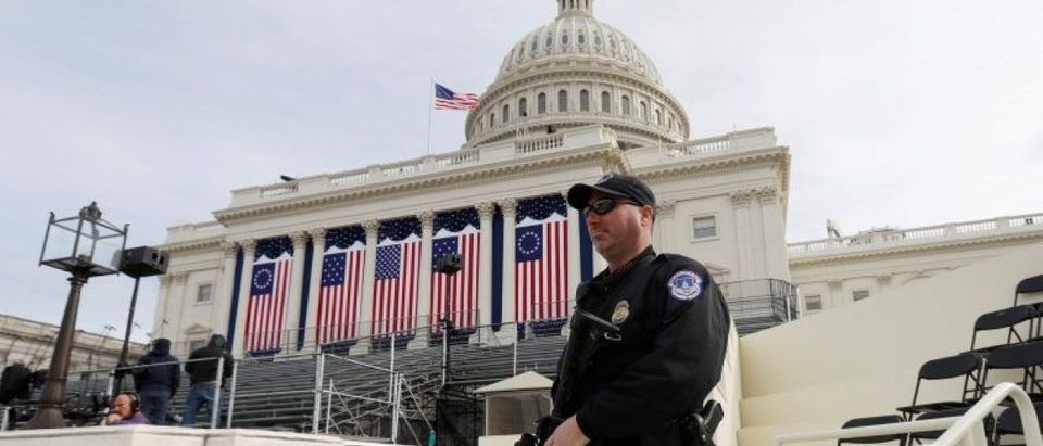 A Capitol Police officer stands guard at the U.S. Capitol before the inauguration of U.S. President Elect Donald Trump in Washington