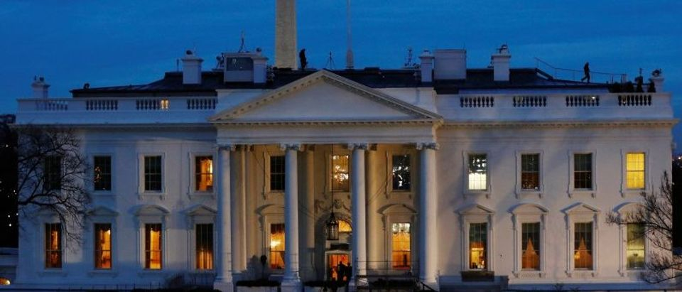 Security personnel walk on the roof of then White House near Pennsylvania Avenue before Inauguration Day for U.S. President-elect Donald Trump in Washington