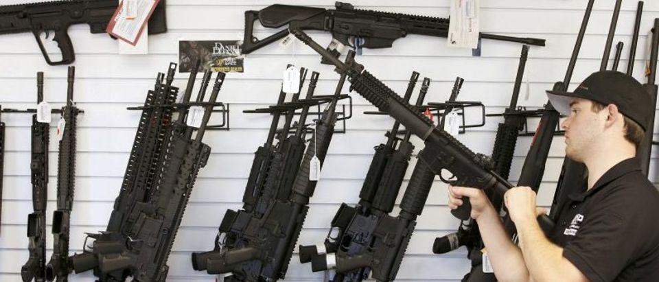 "File photo of salesman Ryan Martinez clearing the chamber of an AR-15 at the ""Ready Gunner"" gun store In Provo"