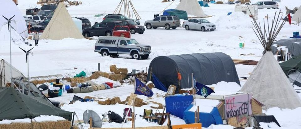 Signs hang in the Dakota Access Pipeline protest camp on the edge of the Standing Rock Sioux Reservation near Cannon Ball