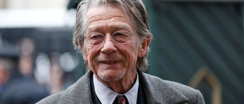 FILE PHOTO: Actor John Hurt arrives for a memorial service for actor and director Richard Attenborough at Westminster Abbey in London