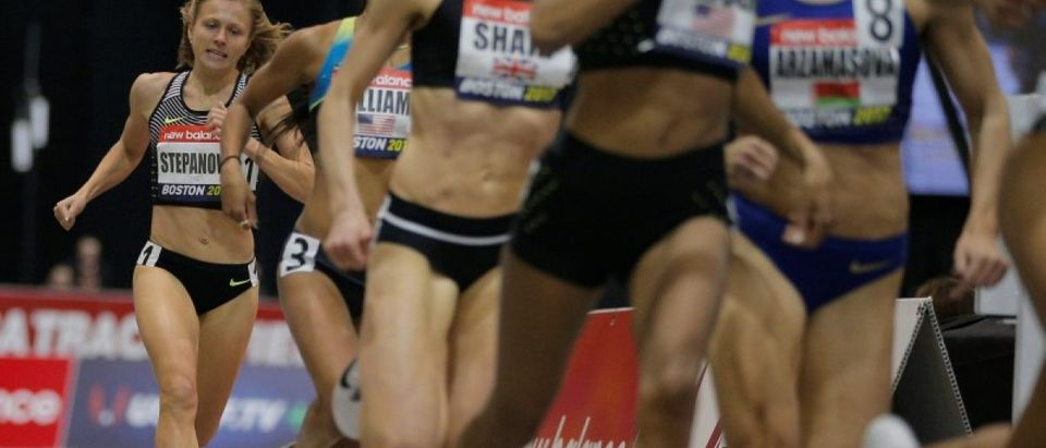 Russian whistleblower and runner Yulia Stepanova (R), who helped expose massive doping problems in Russia that led to the country's track and field team being banned from international competition, competes as a neutral athlete in the 800 meter race at the Boston Indoor Grand Prix in Boston, Massachusetts, U.S. January 28, 2017. REUTERS/Brian Snyder