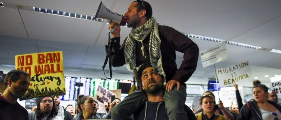 Demonstrators shout slogans during anti-Donald Trump immigration ban protests inside Terminal 4 at San Francisco International Airport in San Francisco