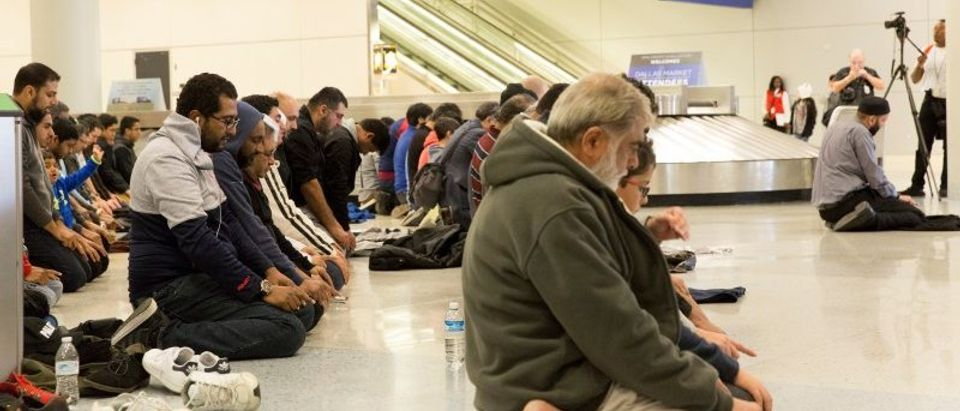People gather to pray in baggage claim during a protest against the travel ban at Dallas/Fort Worth International AirportReuters/Laura Buckman.