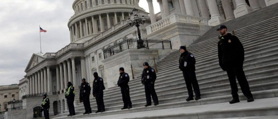 Capitol Hill Police officers look on as activists gather at the US Capitol to protest President Donald Trump's executive actions on immigration