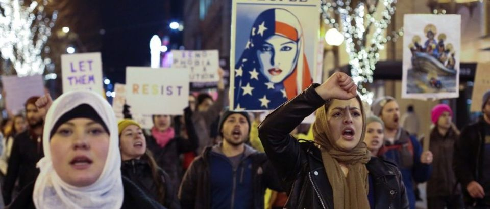People march through downtown Seattle during a protest held in response to President Donald Trump's travel ban, in Seattle