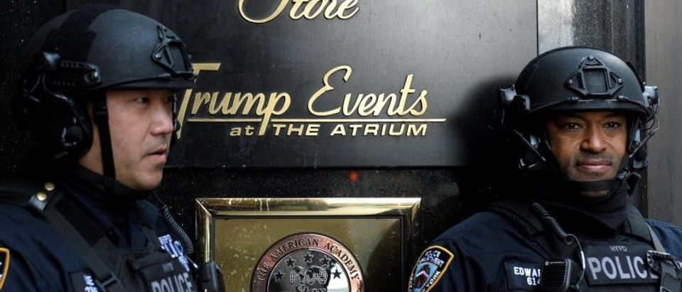 Heavily armed New York City Police (NYPD) officers stand guard in front of Trump Tower where Republican president-elect Donald Trump lives in the Manhattan borough of New York