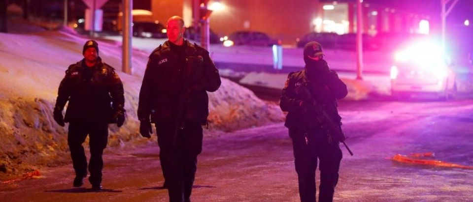 Police officers patrol the perimeter near a mosque after a shooting in Quebec City, January 29, 2017. REUTERS/Mathieu Belanger
