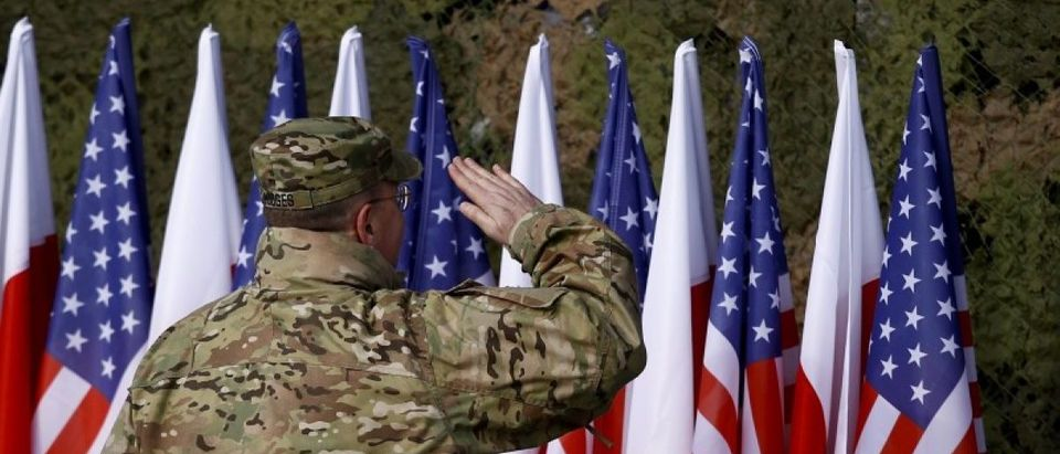 U.S Army Europe Commanding General Hodges salutes during the inauguration ceremony of bilateral military training between U.S. and Polish troops in Zagan