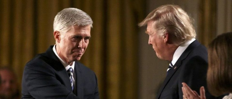 Judge Neil Gorsuch shakes hands with U.S. President Donald Trump as Gorsuch's wife Louise applauds after President Trump nominated Gorsuch to be an associate justice of the U.S. Supreme Court at the White House in Washington