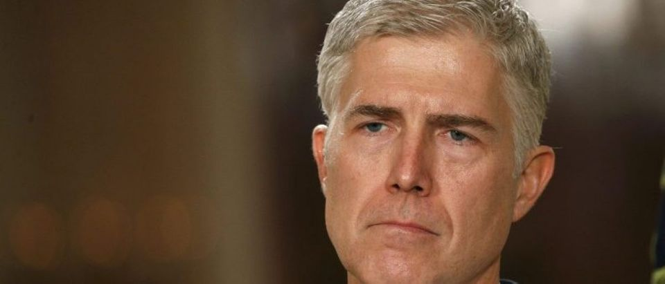 Neil Gorsuch listens as U.S. President Donald Trump announces his nomination of Gorsuch to be an associate justice of the U.S. Supreme Court at the White House in Washington