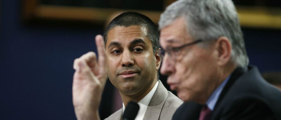 Commissioner Ajit Pai listens to Chairman Tom Wheeler in 2016: Kevin Lamarque/Reuters