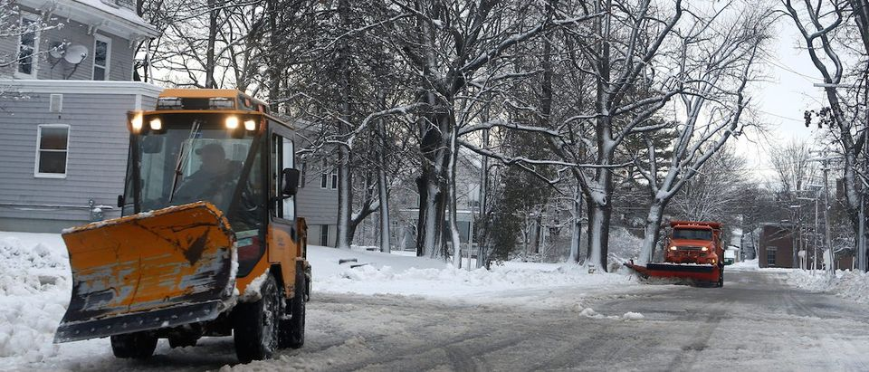 A sidewalk plow and a street plow work to clear a neighborhood in Bangor