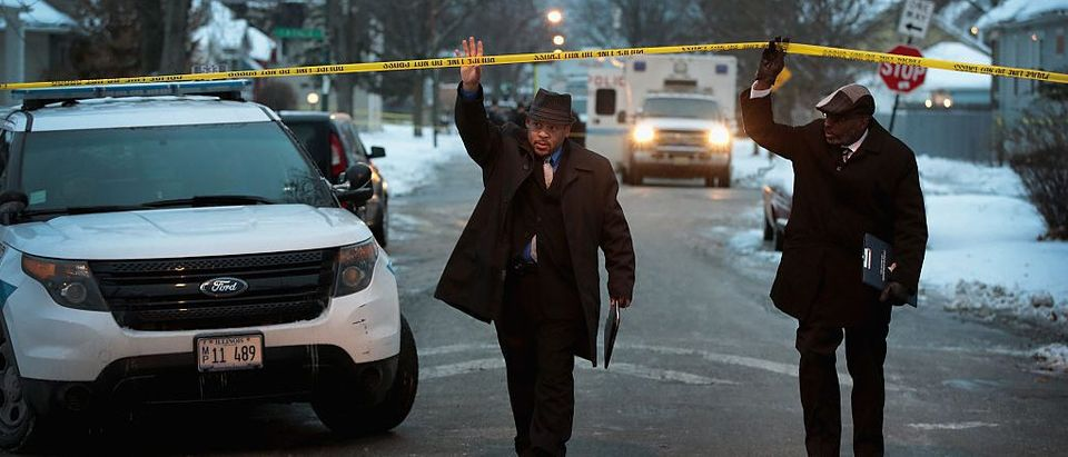 Police investigate the scene of a quadruple homicide on Chicago's Southside on December 17, 2016. (Getty Images)