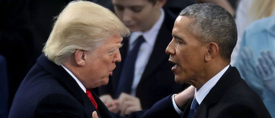 Donald Trump shakes hands with Barack Obama (Getty Images)
