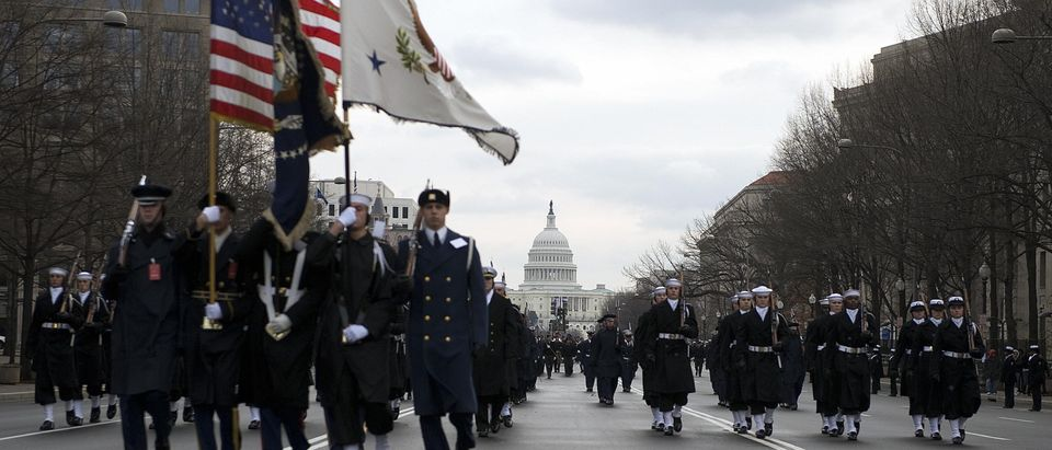 A US military honor guard marches down Pennslyvania Avenue during a dress rehearsal of the Inauguration Parade January 11, 2009, in Washington, DC. Barack Obama will be installed as the 44th president of the US on January 20. AFP PHOTO/Jim WATSON (Photo credit should read JIM WATSON/AFP/Getty Images)