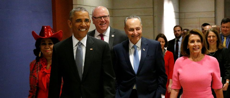 U.S. President Barack Obama arrives with Rep. Frederica Wilson (D-FL), New York Rep. Joe Crowley (D-NY), Senate Democratic Leader Chuck Schumer and House Democratic Leader Nancy Pelosi to meet with House and Senate Democrats in the U.S. Capitol in Washington January 4, 2017. REUTERS/Kevin Lamarque