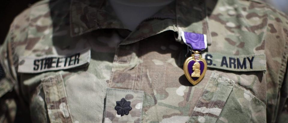 U.S. Secretary of Defense Robert Gates awards a Purple Heart at COP Andar in Afghanistan