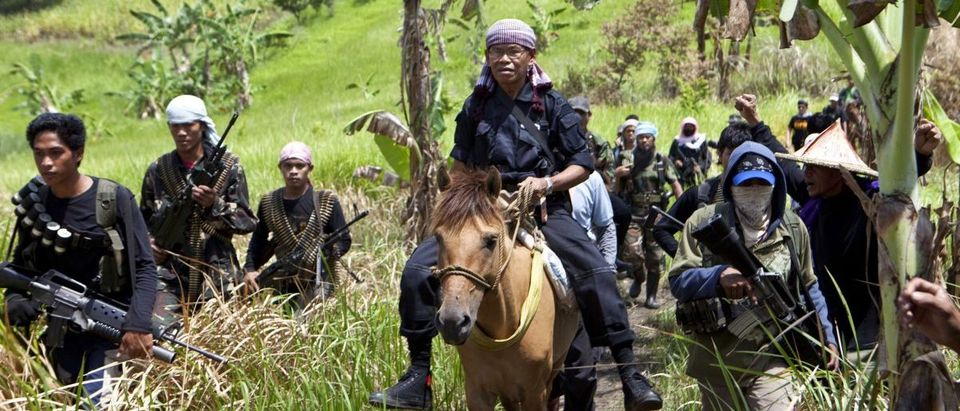 Moro Islamic Liberation Front rogue commander Ustadz Ameril Umbra Kato arrives with his followers before a clandestine news conference in Maguindanao