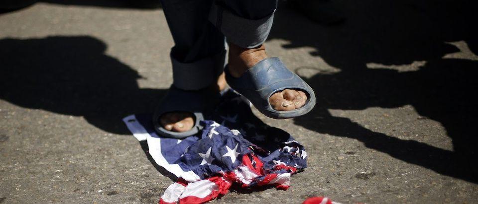 Palestinian steps on a U.S. flag during a protest against the visit of U.S. President Barack Obama, in Gaza City