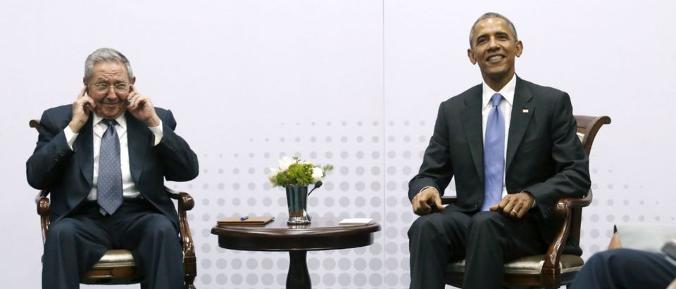 Cuba's President Raul Castro pretends not to hear questions from journalists as he and U.S. President Barack Obama hold a bilateral meeting during the Summit of the Americas in Panama City, Panama April 11, 2015. Neither president took questions from the press. Obama and Castro shook hands on Friday at the summit, a symbolically charged gesture as the pair seek to restore ties between the Cold War foes. REUTERS/Jonathan Ernst