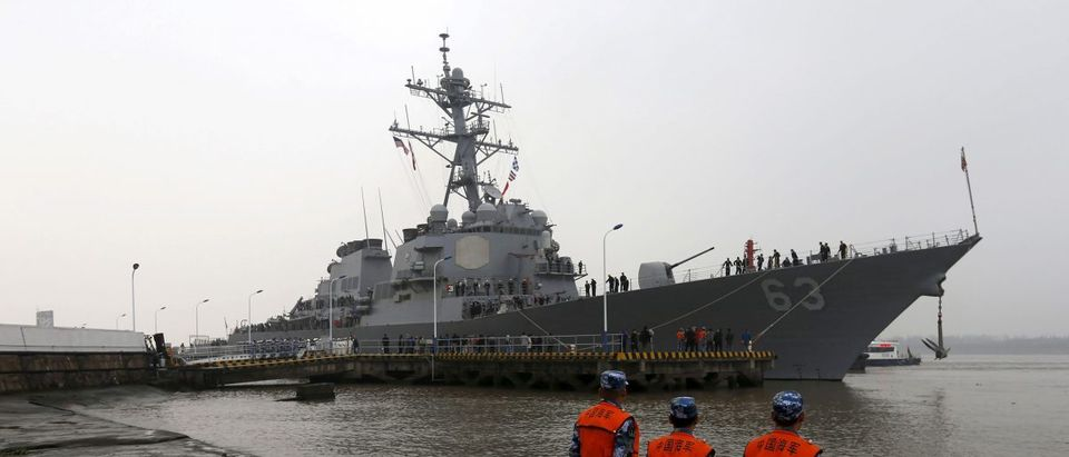 Chinese People's Liberation Army navy soldiers stand guard as USS Stethem destroyer vessel arrives at a military port for an official visit, in Shanghai,