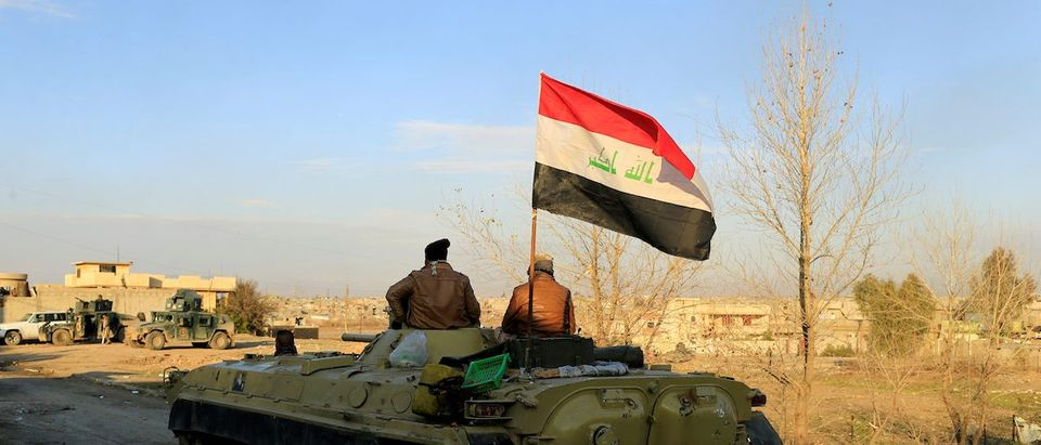 An Iraqi flag is seen on a military vehicle during battle with Islamic State militants in the Mithaq district of eastern Mosul, Iraq, January 3, 2017. REUTERS/Thaier Al-Sudani