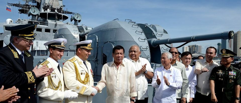 Philippine President Duterte shakes hands with Russia's Rear Admiral Mikhailov at the anti-submarine navy ship Admiral Tributs at the south pier in Metro Manila