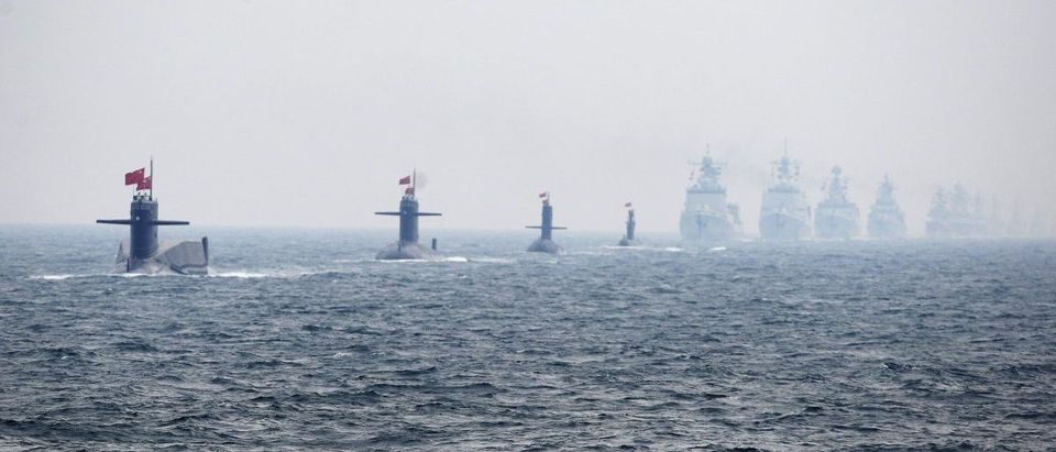 Chinese Navy submarines and warships take part in an international fleet review to celebrate the 60th anniversary of the founding of the People's Liberation Army Navy in Qingdao
