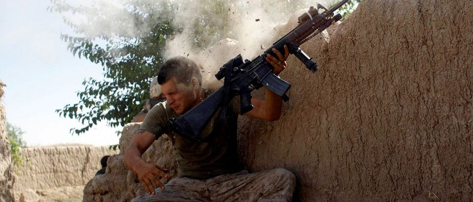 File photo of Sgt. William Olas Bee, a U.S. Marine coming under Taliban fire in Helmand