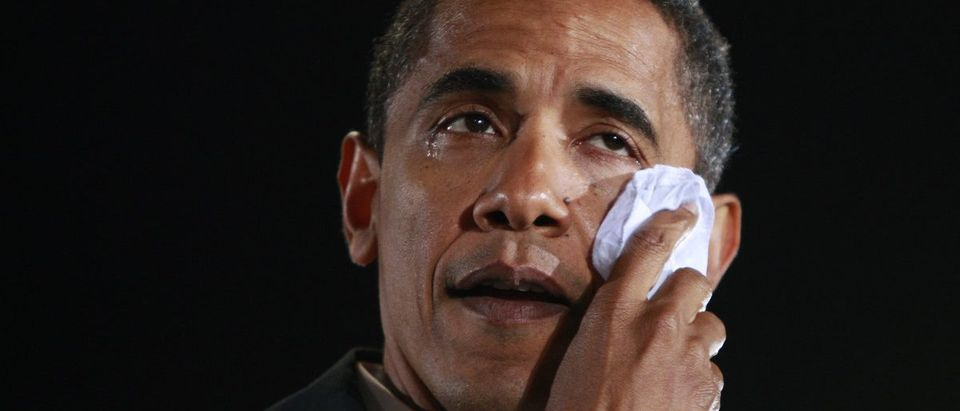 Democratic presidential nominee Obama wipes a tear from his eye during a campaign rally in Charlotte