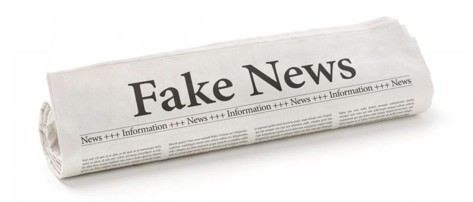 "Here is a mainstream newspaper showing ""fake news."" [Shutterstock - 556324534]"