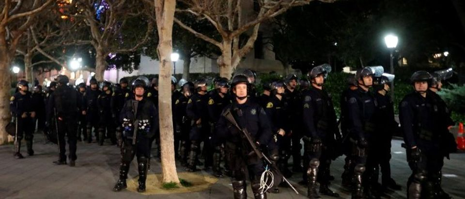 Police officers prepare to deploy a skirmish line at UC Berkeley
