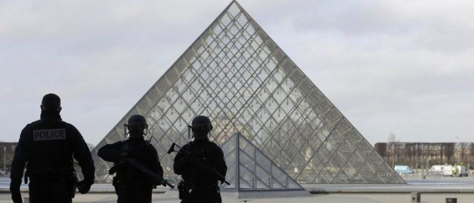 French police secure the site near the Louvre Pyramid in Paris