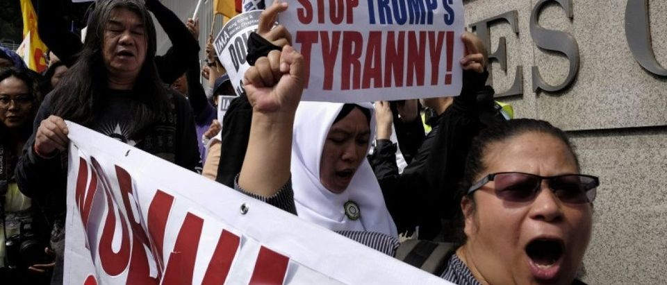 Protesters demonstrate against U.S. President Donald Trump's executive order on immigration, in Hong Kong, China February 5, 2017. REUTERS/Bobby Yip