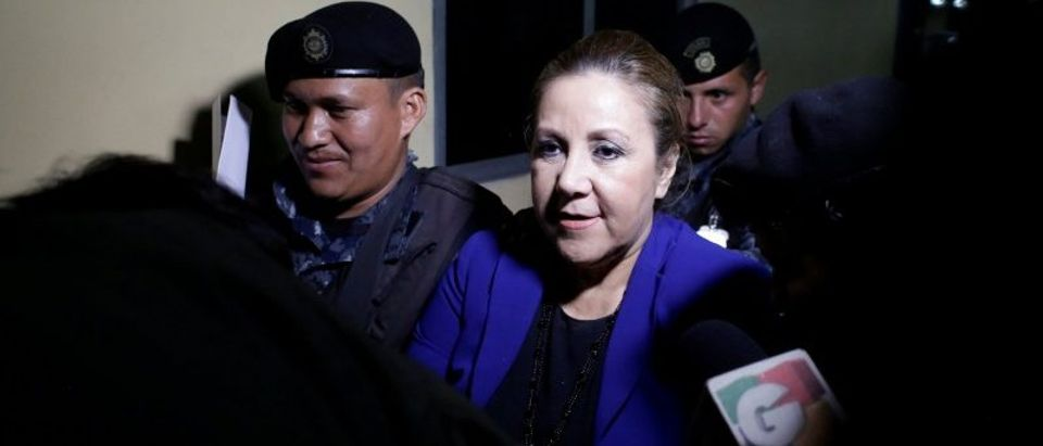 Guatemalan Supreme Court judge Blanca Stalling is escorted by policemen after being arrested on influence trafficking, at the Supreme Court of Justice in Guatemala City