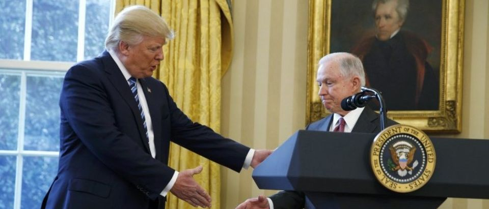 U.S. President Trump congratulates new U.S. Attorney General Sessions after being sworn in at the White House in Washington