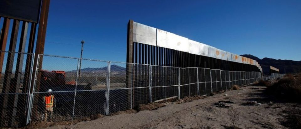 A worker stands next to a newly built section of the U.S.-Mexico border fence at Sunland Park, U.S. opposite the Mexican border city of Ciudad Juarez REUTERS/Jose Luis Gonzalez