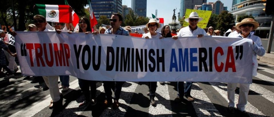 Demonstrators hold a banner during a march to protest against U.S. President Donald Trump's proposed border wall, and to call for unity, in Mexico City, Mexico
