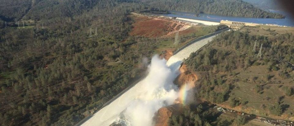A damaged spillway with eroded hillside is seen in an aerial photo taken over the Oroville Dam in Oroville