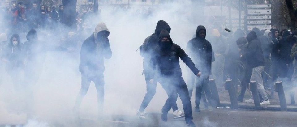 Youths face off with French police during a demonstration against police brutality after a young black man, 22-year-old youth worker named Theo, was severely injured during his arrest earlier this month, in Paris