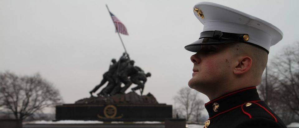 Lance Cpl. Derrick Stevens, awaits his cue to hoist the officer flag at the annual commemoration ceremony recognizing the flag-raisings on Iwo Jima in 1945. Marines - past and present - attended the ceremony, Feb. 23, 2010, in remembrance of the historic World War II battle at the Marine Corps War Memorial, Arlington, Va. The ceremony honored the sacrifices of the Marines and sailors who fought the epic battle and the fallen Marines of all wars, to whom the memorial is dedicated. Marine Corps/Flickr