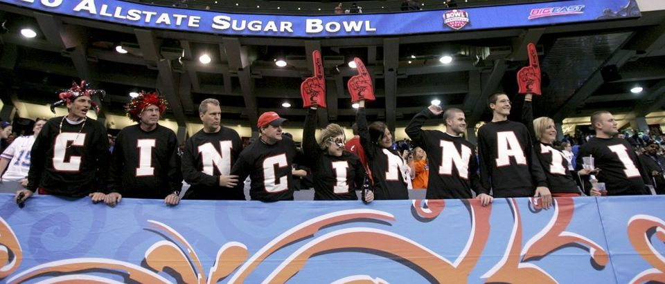 University of Cincinnati fans cheer as the team runs out onto the field just before their NCAA Sugar Bowl football game in New Orleans