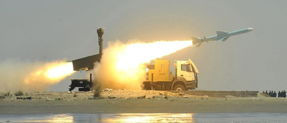 A Noor missile is fired from its launch vehicle during a war game by the Iranian army near Jask port