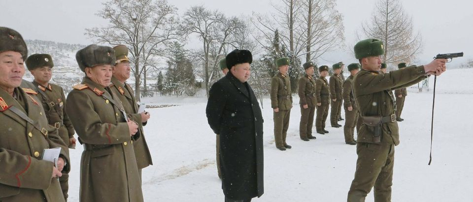 North Korean leader Kim Jong Un stands in the snow as he inspects KPA Unit 1313 honored with the title of O Jung Hup-led 7th Regiment