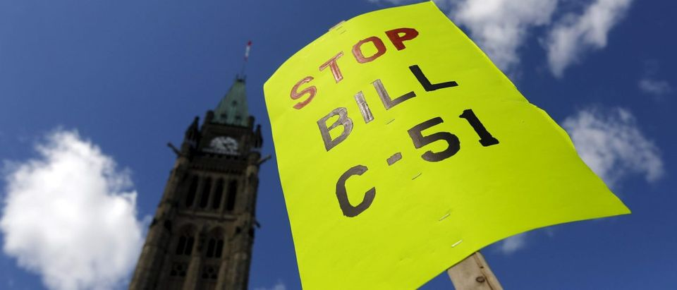 A sign is pictured during a demonstration against Bill C-51, the Canadian government's proposed anti-terror legislation, on Parliament Hill in Ottawa April 18, 2015. REUTERS/Chris Wattie