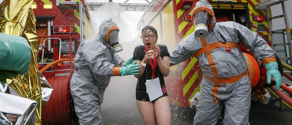 Firemen wearing chemical protective suits take part in a mock chemical attack exercise
