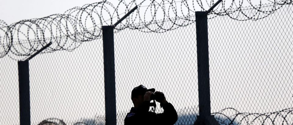 Polish policeman patrols at the Hungary and Serbia border fence near the village of Asotthalom