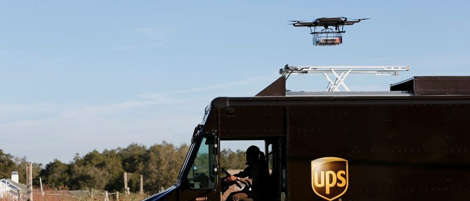 A drone demonstrates delivery capabilities from the top of a UPS truck during testing in Lithia, Florida