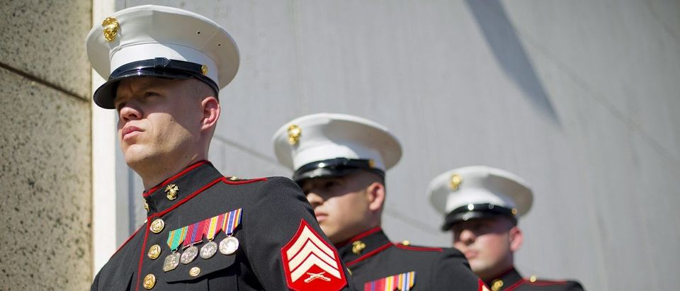 U.S. Marines, currently stationed in Cuba, stand at the ready for the raising of the U.S. flag over the newly reopened embassy in Havana
